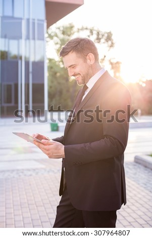 Picture of attractive man making career in big city - stock photo