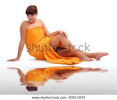 Picture of attractive suntanned girl dressed in orange towel on white tropical beach - stock photo