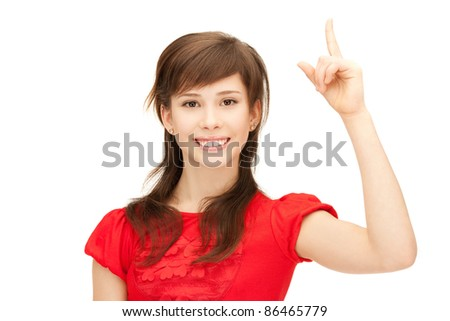 picture of attractive teenage girl with her finger up - stock photo