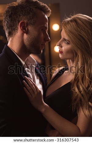 Picture of attractive woman seducing handsome man - stock photo