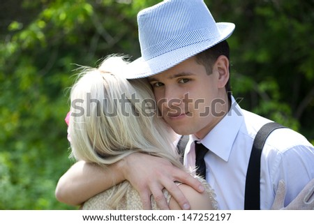 Picture of beautiful couple hugging outdoors - stock photo