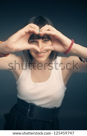 Picture of beautiful girl forming heart shape - stock photo