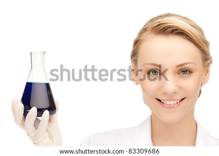 picture of beautiful lab worker holding up test tube - stock photo
