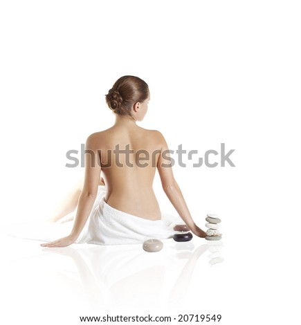 picture of beautiful lady with wite towels on white sand - stock photo