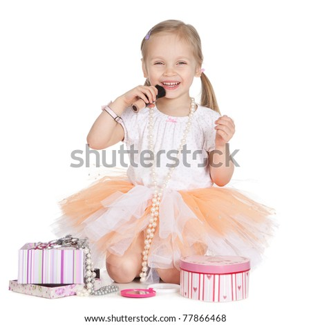 Picture of beautiful little girl applying makeup over white - stock photo