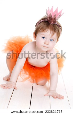 Picture of beautiful little princess girl with a mirror over white. An adorable baby girl sitting pretty in her pink and black princess costume. Isolated on white. - stock photo