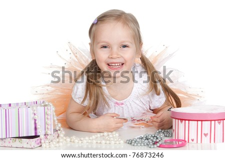 Picture of beautiful little princess girl with accessories over white - stock photo