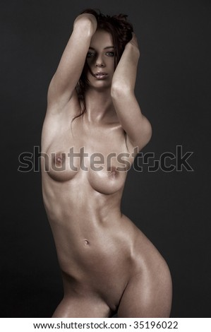 picture of beautiful naked woman over grey - stock photo