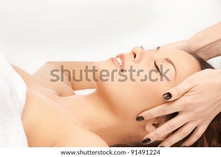 picture of beautiful woman in massage salon - stock photo