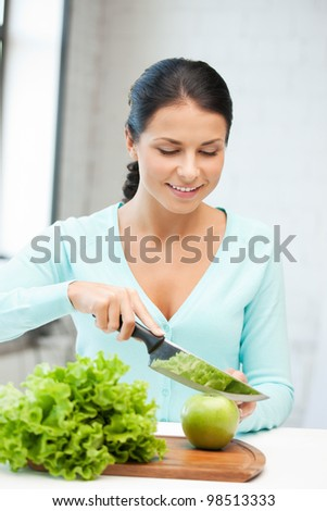 picture of beautiful woman in the kitchen. - stock photo