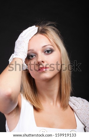 picture of beautiful woman in white gloves black background - stock photo