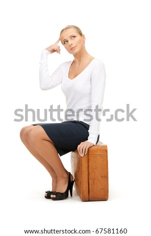 picture of beautiful woman with brown suitcase - stock photo