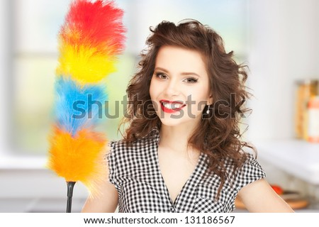picture of beautiful woman with cleaning sweep - stock photo