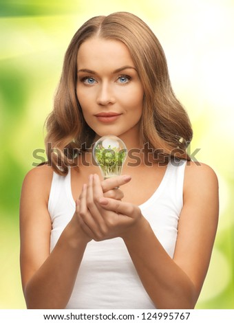 picture of beautiful woman with energy saving bulb - stock photo