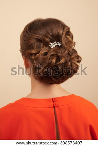 Picture of beautiful woman with gorgeous hairstyle in red dress - stock photo