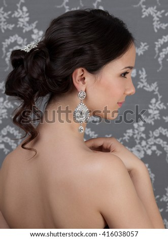 Picture of beautiful woman with hairstyle and makeup - stock photo
