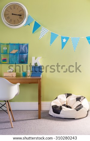 Picture of boy room with comfortable football sack chair - stock photo