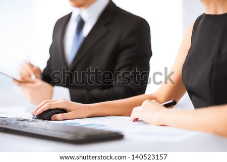 picture of business team on meeting using computer - stock photo