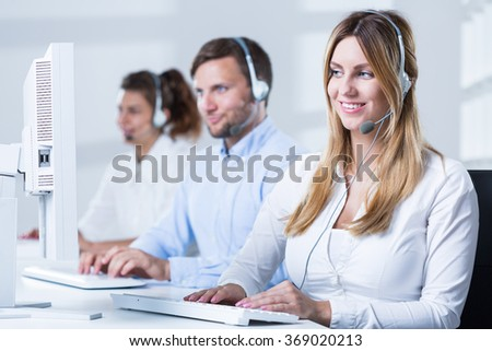 Picture of call center consultant with computer during work  - stock photo