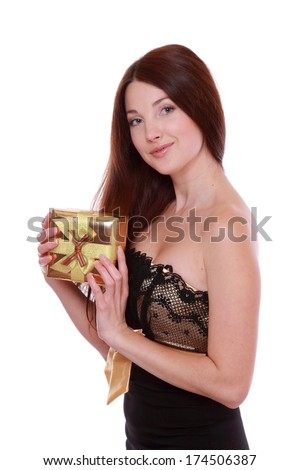 picture of cheerful girl in black and gold dress with gift box - stock photo