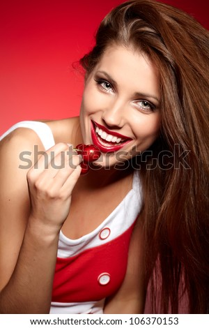 picture of cherry and lips over red background - stock photo