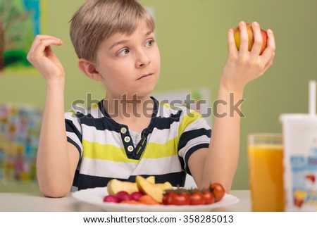 Picture of child eating healthy vitamin breakfast - stock photo