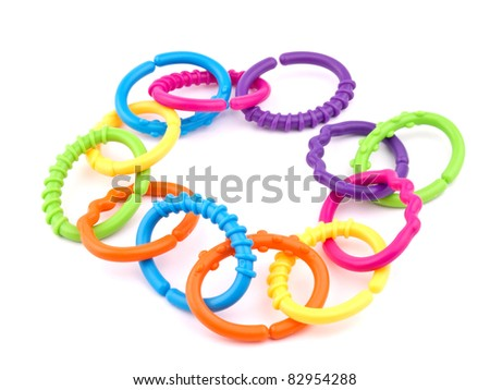 Picture of colorful teething rings on white background. - stock photo