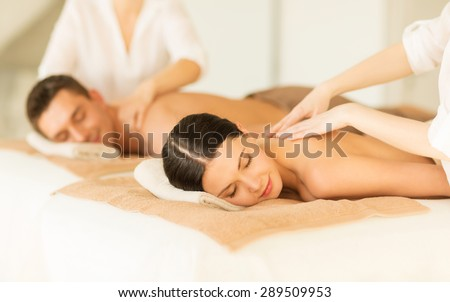 picture of couple in spa salon getting massage - stock photo