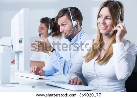 Picture of female telemarketer with headset during work - stock photo