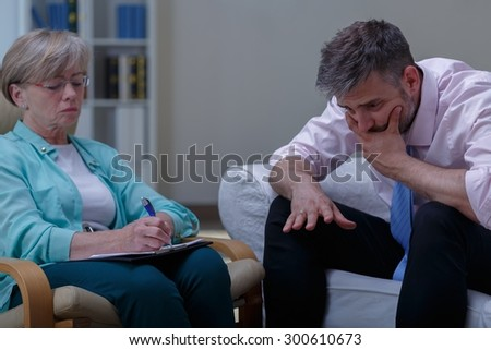 Picture of female therapist analysing problem of despair patient - stock photo