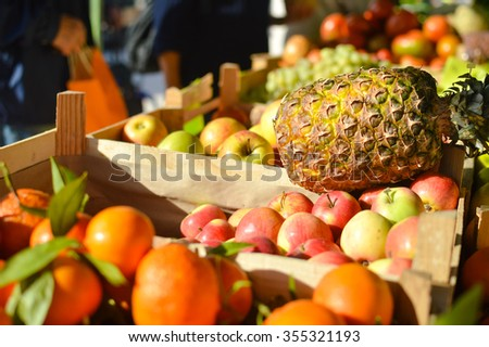 Picture of fresh fruits and vegetables at market in boxes on colorful background - stock photo
