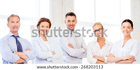 picture of friendly business team in office - stock photo