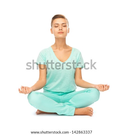 picture of girl sitting in lotus position and meditating - stock photo
