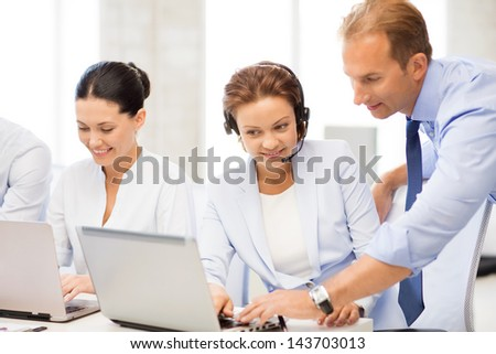 picture of group of people working in call center or office - stock photo