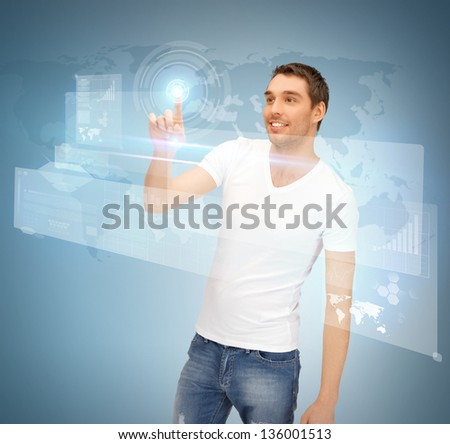 picture of handsome man touching virtual screen - stock photo