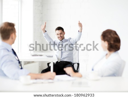 picture of happy businessman showing thumbs up in office - stock photo