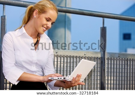 picture of happy businesswoman with laptop computer - stock photo