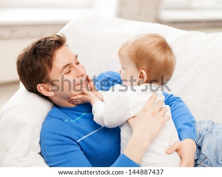 picture of happy father with adorable baby - stock photo