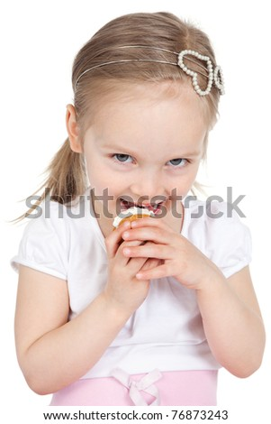 Picture of happy little girl eating cake isolated on white background - stock photo