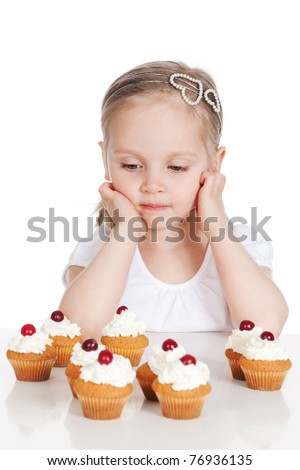Picture of happy little girl with cakes isolated on white background - stock photo