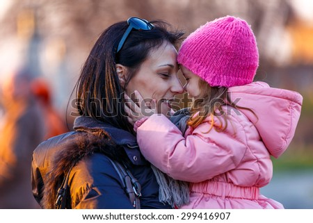 picture of happy mother with child in a park / Mother and Daughter - stock photo
