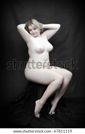 Picture of happy overweight woman posing on a black background, vintage style photography. - stock photo