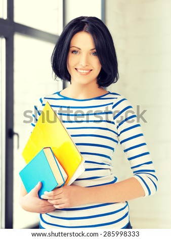 picture of happy teenage girl with books and folders - stock photo