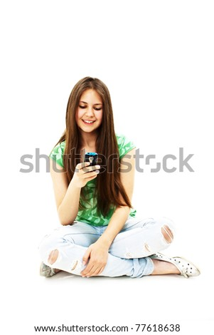 Picture of happy teenage girl with cell phone - stock photo