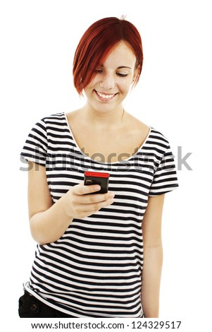 Picture of happy teenage girl with cell phone. Isolated on white background - stock photo