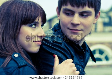 Picture of happy woman and man (focus on woman) - stock photo