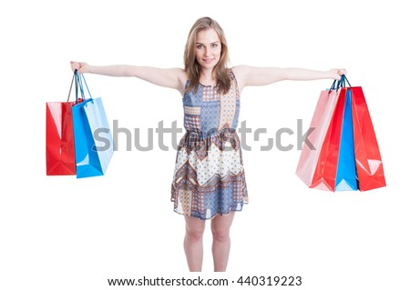 Picture of happy woman holding colorful shopping bags in her hands as fun and relaxation concept isolated on white background - stock photo