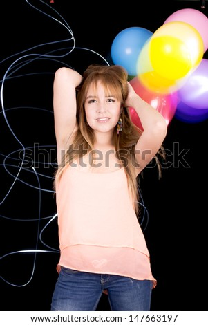 picture of happy woman with balloons - stock photo
