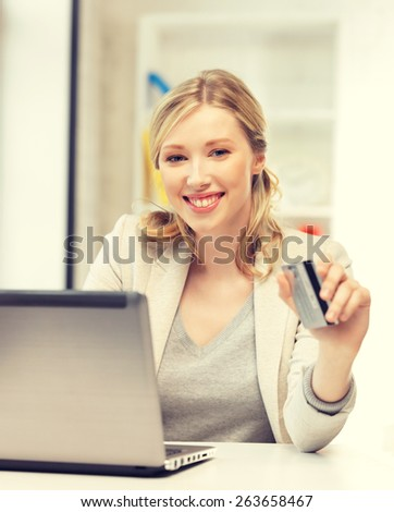 picture of happy woman with laptop computer and credit card. - stock photo