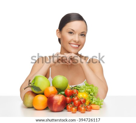 picture of happy woman with lot of fruits and vegetables - stock photo